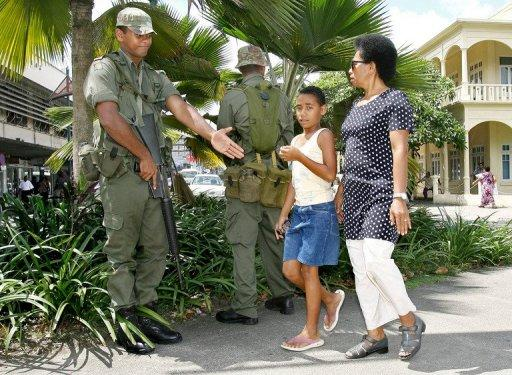 Soldiers chat to locals in Suva