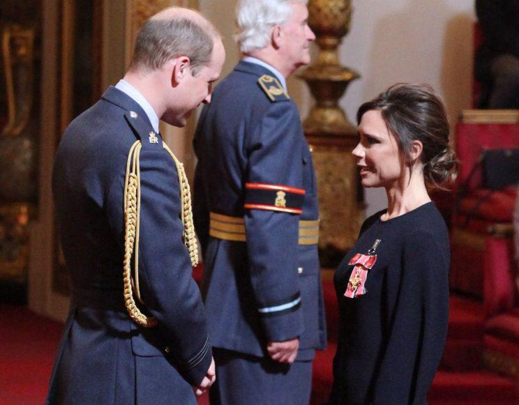 Victoria Beckham was all smiles while receiving her OBE from Prince William