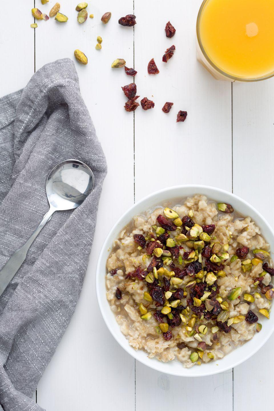"<p>Skip the sugary toppings and add dried fruit and nuts to your oatmeal.</p><p>Get the recipe from <a href=""https://www.delish.com/cooking/recipe-ideas/recipes/a44505/maple-oatmeal-with-cranberries-and-pistachios-recipe/"" rel=""nofollow noopener"" target=""_blank"" data-ylk=""slk:Delish"" class=""link rapid-noclick-resp"">Delish</a>.</p>"