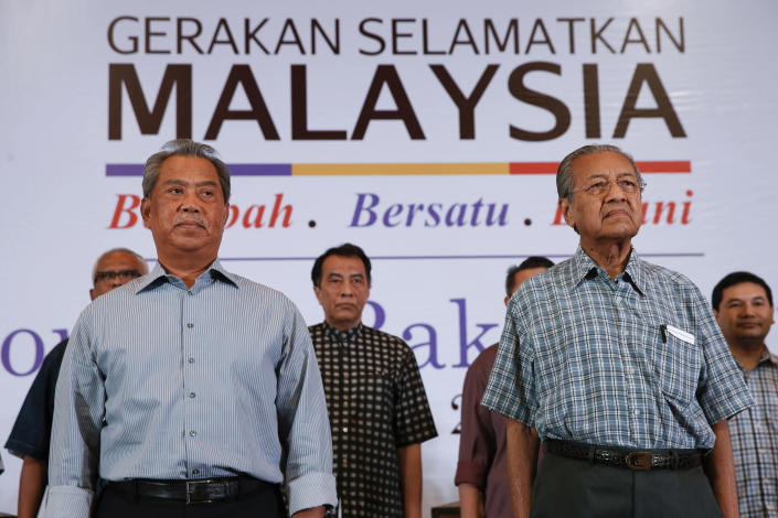 "FILE - In this March 27, 2016, photo, Malaysia's former Prime Minister Mahathir Mohamad, right, and former Deputy Prime Minster Muhyiddin Yassin attend the ""People's Congress 2016"" event in Shah Alam, Malaysia. Bersatu party said in a statement Friday, Feb. 28, 2020 that 36 lawmakers, including nearly a dozen who defected from Anwar Ibrahim's party, have decided to support party President Muhyiddin Yassin instead of Mahathir as prime minister. (AP Photo/Vincent Thian, File)"