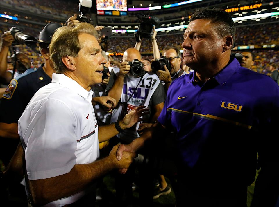 Nick Saban of the Alabama Crimson Tide shakes hands with head coach Ed Orgeron of the LSU Tigers after their 10-0 win at Tiger Stadium on Nov. 5, 2016 in Baton Rouge, Louisiana. (Photo by Kevin C. Cox/Getty Images)