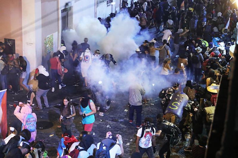 Police clash with protesters as they demonstrate against Gov. Ricardo Rossello on July 22, 2019, in Old San Juan, Puerto Rico.
