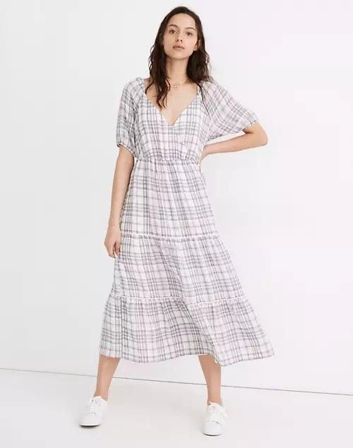 <p>You'll never tire of this <span>Madewell Puff-Sleeve Faux-Wrap Tiered Midi Dress</span> ($148).</p>