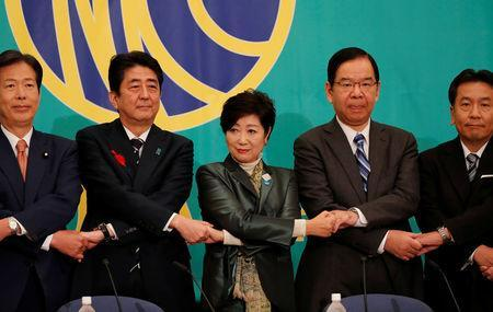 Leaders of Japan's main political parties (L-R) Komeito Party leader Natsuo Yamaguchi, Japan's Prime Minister Shinzo Abe, head of Japan's Party of Hope and Tokyo Governor Yuriko Koike, Communist Party Chairman Kazuo Shii and Constitutional Democratic Party leader Yukio Edano pose for a photograph at the start of debate session ahead of October 22 lower house election, at the Japan National Press Club in Tokyo, Japan October 8, 2017. REUTERS/Kim Kyung-Hoon