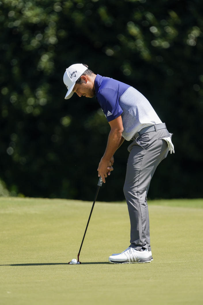Xander Schauffele lines up a putt on the second hole during the final round of the Tour Championship golf tournament at East Lake Golf Club in Atlanta, Monday, Sept. 7, 2020. (AP Photo/John Bazemore)