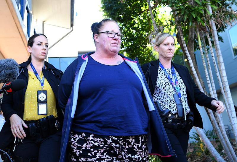 Shannon White (centre) is taken from the Morningside police station after she was arrested in Brisbane on Wednesday. Source: AAP