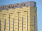 <p>Broken windows are seen on the 32nd floor of the Mandalay Bay Resort and Casino after Stephen Paddock opened fire on the crowds below. (Getty) </p>