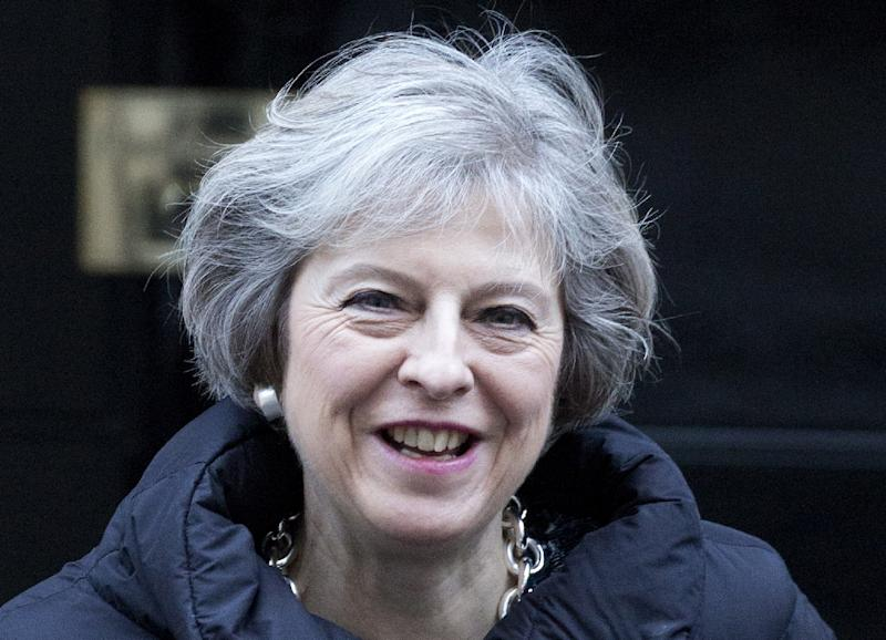 """British Prime Minister Theresa May congratulated US President Donald Trump saying both were committed to """"advancing the special relationship"""" between their countries"""