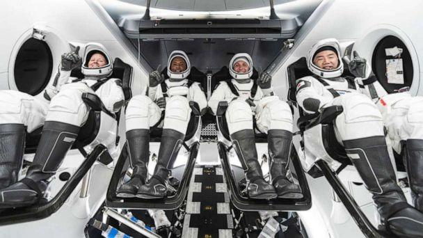 PHOTO: NASA astronauts Shannon Walker, Victor Glover, and Mike Hopkins, and astronaut Soichi Noguchi of the Japan Aerospace Exploration Agency - who constitute the crew of NASA's Crew-1 mission, inside SpaceX's Crew Dragon spacecraft. (SpaceX via NASA)