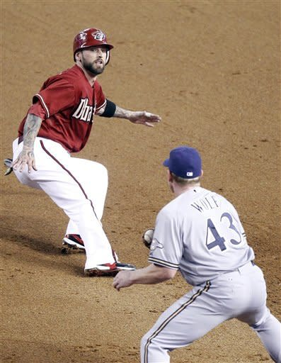 Arizona Diamondbacks' Ryan Roberts, top, turns to head to second as Milwaukee Brewers' Randy Wolf, bottom, covers first base to catch him in a rundown on a steal-attempt in the fourth inning of a baseball game on Sunday, May 27, 2012, in Phoenix. Roberts was tagged out on the play. (AP Photo/Paul Connors)