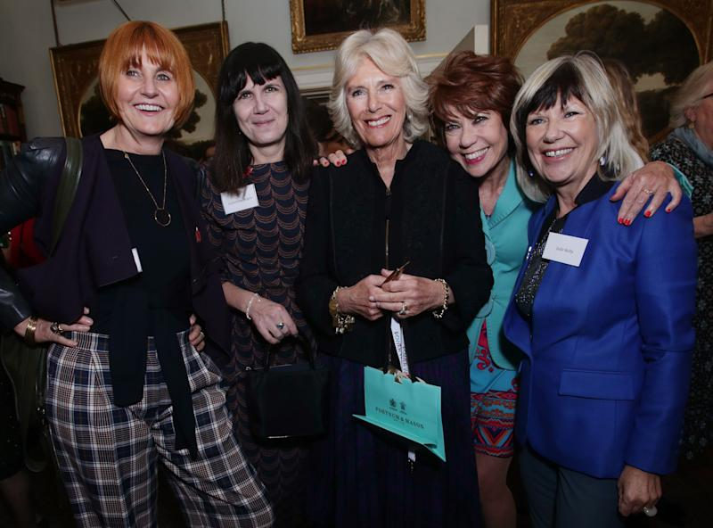 (L-R) Mary Portas, Catherine Mayer, co-founder of the Women's equality party, Britain's Camilla, Duchess of Cornwall, Kathy Lette and Jude Kelly pose during a reception at Clarence House in London to celebrate the Southbank Centre's WOW - Women of the World festival on March 8, 2018. / AFP PHOTO / POOL / Yui Mok (Photo credit should read YUI MOK/AFP via Getty Images)