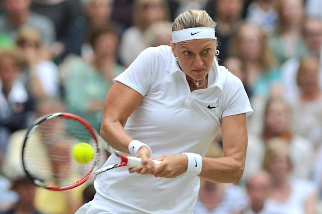Czech Republic's Petra Kvitova hits a return to Canada's Eugenie Bouchard during the women's final match on day twelve of the Wimbledon Championships at The All England Tennis Club in southwest London, on July 5, 2014 (AFP Photo/Glyn Kirk)