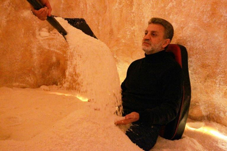 A specialist in alternative medicine covers the body of a client with salt at the Opal salt treatment centre in Libya's eastern city of Benghazi, once the cradle of the 2011 uprising that ousted the regime of dictator Moamer Kadhafi