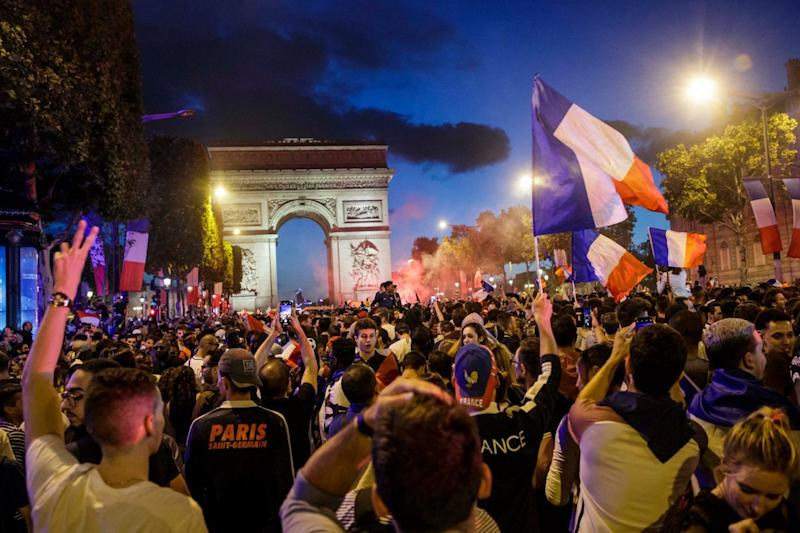 Huge crowds gathered on the Champs Elysee in Paris to celebrate France's semi-final win (EPA)