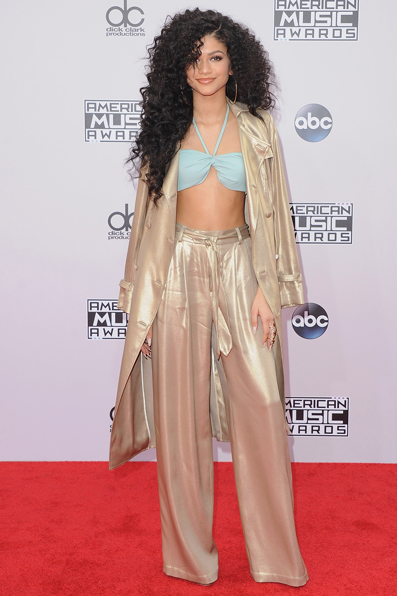 """<p>Zendaya served chic '70s vibes in this metallic co-ord, complete with a pastel halterneck and voluminous curls at the <a href=""""https://www.cosmopolitan.com/uk/fashion/celebrity/news/a31420/2014-american-music-awards-jennifer-lopez-sexy-outfits/"""" rel=""""nofollow noopener"""" target=""""_blank"""" data-ylk=""""slk:2014 American Music Awards"""" class=""""link rapid-noclick-resp"""">2014 American Music Awards</a>.</p>"""