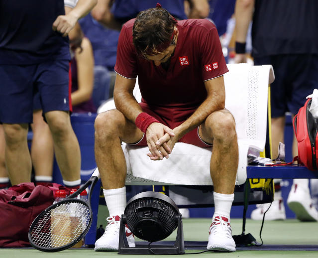 "<a class=""link rapid-noclick-resp"" href=""/olympics/rio-2016/a/1221919/"" data-ylk=""slk:Roger Federer"">Roger Federer</a> sits in front of a fan during a changeover in his match against <a class=""link rapid-noclick-resp"" href=""/olympics/rio-2016/a/1128002/"" data-ylk=""slk:John Millman"">John Millman</a>. (AP)"