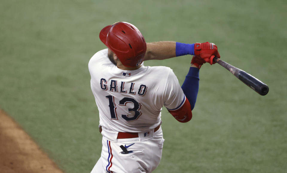 ARLINGTON, TX - JUNE 26: Joey Gallo #13 of the Texas Rangers hits a three-run home run against the Kansas City Royals during the fourth inning at Globe Life Field on June 26, 2021 in Arlington, Texas.(Photo by Ron Jenkins/Getty Images)