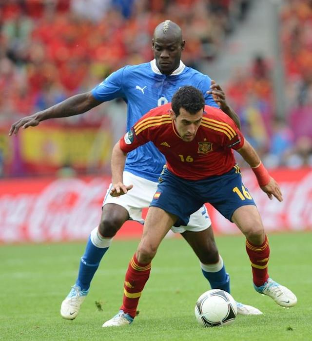 Italian forward Mario Balotelli (L) vies with Spanish midfielder Sergio Busquets during the Euro 2012 championships football match Spain vs Italy on June 10, 2012 at the Gdansk Arena. AFP PHOTO / CHRISTOF STACHECHRISTOF STACHE/AFP/GettyImages