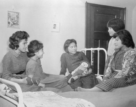 Girls sit on beds in a dormitory at the Shingwauk Indian Residential School in Sault Ste Marie, Ontario in a 1960 archive photo. REUTERS/Department of Citizenship and Immigration-Information Division/Library and Archives Canada/PA-185528/handout
