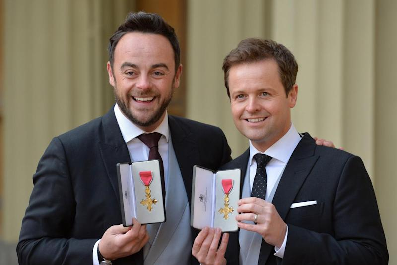 Ant McPartlin poses with showbiz partner Declan Donnelly after receiving OBEs in the New Year's honours (John Stillwell/WPA Pool/Getty Images)