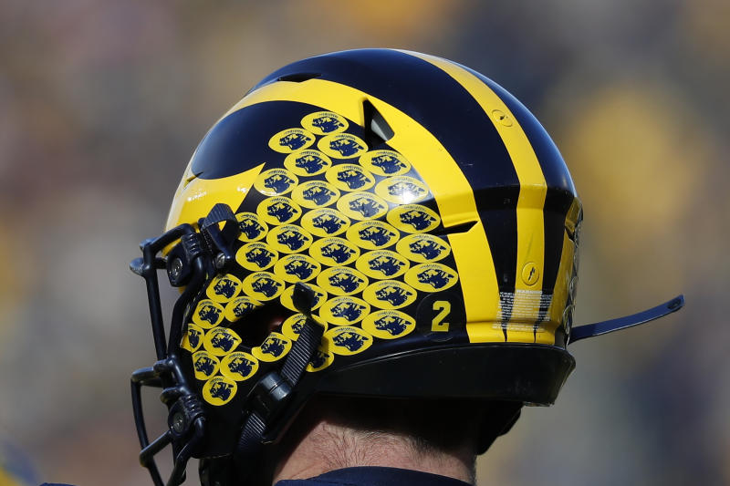 Michigan quarterback Shea Patterson's helmet is shown in the first half of an NCAA college football game against Michigan State in Ann Arbor, Mich., Saturday, Nov. 16, 2019. (AP Photo/Paul Sancya)