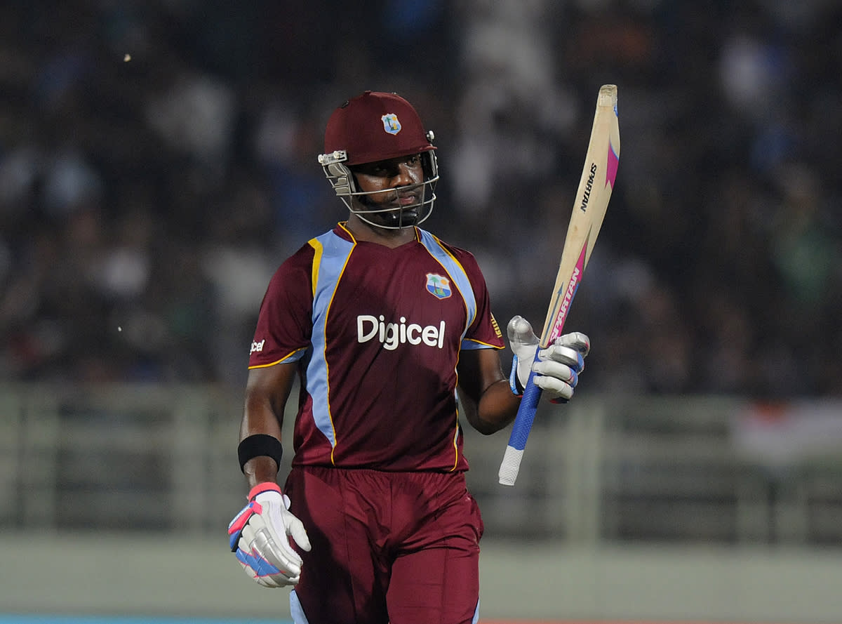 Darren Bravo of West Indies raises his bat after scoring a half century during the second Star Sports One Day International (ODI) match between India and The West Indies held at the Dr. Y.S. Rajasekhara Reddy ACA-VDCA Cricket Stadium, Vishakhapatnam, India on the 24th November 2013  Photo by: Pal Pillai - BCCI - SPORTZPICS   Use of this image is subject to the terms and conditions as outlined by the BCCI. These terms can be found by following this link:  https://ec.yimg.com/ec?url=http%3a%2f%2fsportzpics.photoshelter.com%2fgallery%2fBCCI-Image-Terms%2fG0000ahUVIIEBQ84%2fC0000whs75.ajndY&t=1501129934&sig=0q_qC6PQ70U.tmoROlSr8Q--~C
