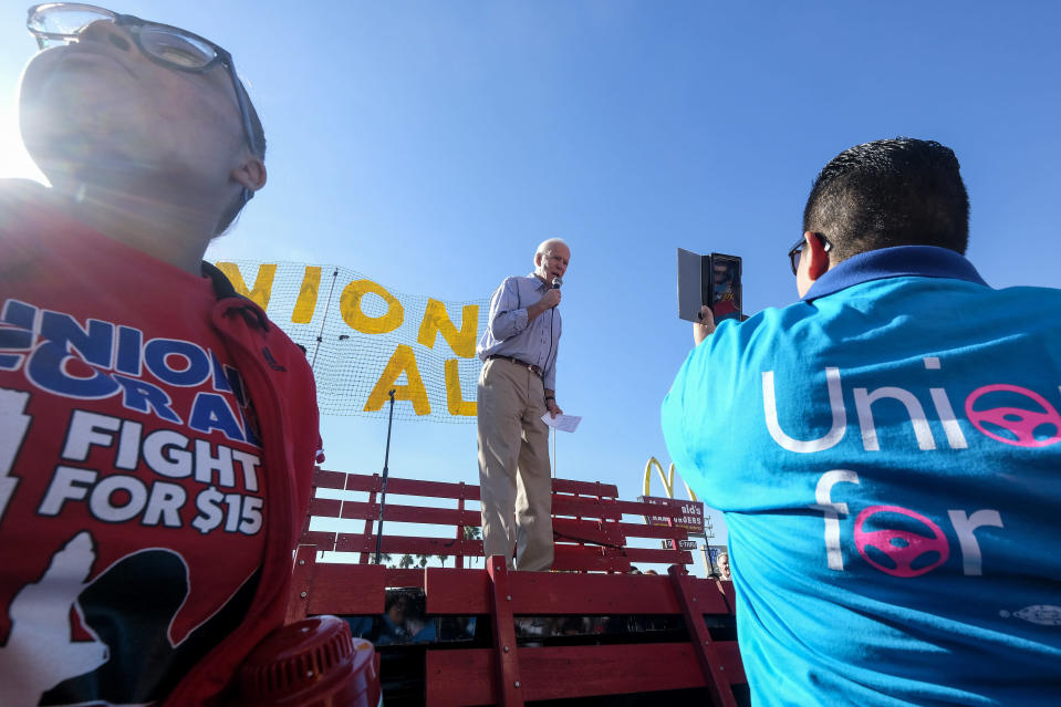 FILE - In this Dec. 19, 2019, file photo Democratic presidential candidate former Vice President Joe Biden, speaks at a rally in support of McDonald's cooks and cashiers who are demanding higher wages and union rights, outside a McDonald's restaurant in Los Angeles. The Biden administration is giving a bit of simple advice to businesses that are unable to find workers: Offer them more money. Boosting wages gets at the central promise of the Biden presidency to improve the lives of everyday. (AP Photo/Ringo H.W. Chiu, File)