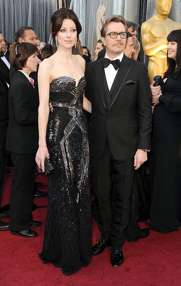 Gary Oldman and Alexandra Edenborough arrive at the 84th Annual Academy Awards in Hollywood, CA.