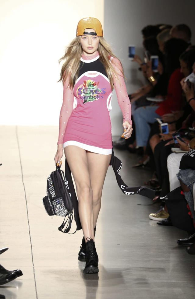Gigi Hadid walks the runway at Jeremy Scott. (Photo: Getty)