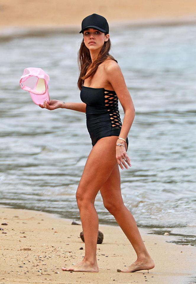 <p>With this black strapless one-piece and its cut-out back, Jessica Alba made beach time during her Hawaiian vacation tres chic. Even with that baseball cap slapped on. (Photo: Splash News) </p>