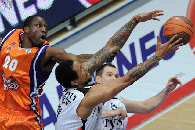 Valencia's Florent Pietrus (L) vies with Lietuvos Rytas' Lawrence Roberts (C) and Steponas Babrauskas during an Eurocup semi-final basketball match between Valencia and Lietuvos Rytas in Khimki, outside Moscow, on April 14, 2012. AFP PHOTO / KIRILL KUDRYAVTSEV (Photo credit should read KIRILL KUDRYAVTSEV/AFP/Getty Images)