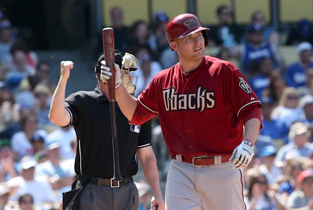 LOS ANGELES, CA - APRIL 20: Mark Trumbo #15 of the Arizona Diamondbacks reacts after striking out with runners on second and third in the seventh inning against the Los Angeles Dodgers at Dodger Stadium on April 20, 2014 in Los Angeles, California. The Dodgers won 4-1. (Photo by Stephen Dunn/Getty Images)