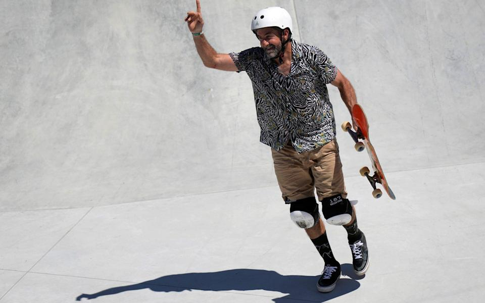 Dallas Oberholzer, at 46, is two years older than the three of the young women champions combined in the skateboarding - AP