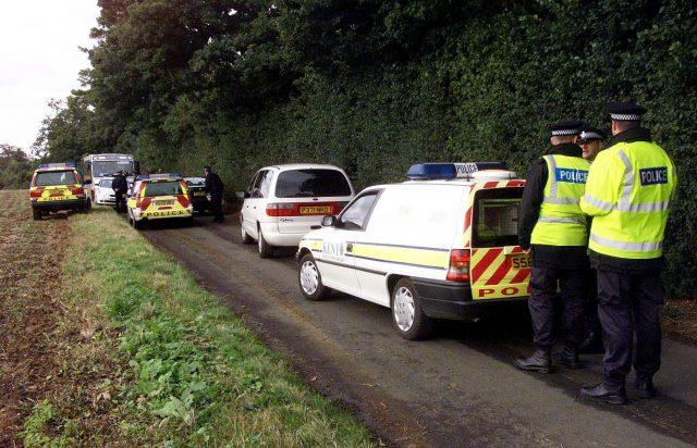 Police activity at the scene where Lin and Megan Russell were battered to death