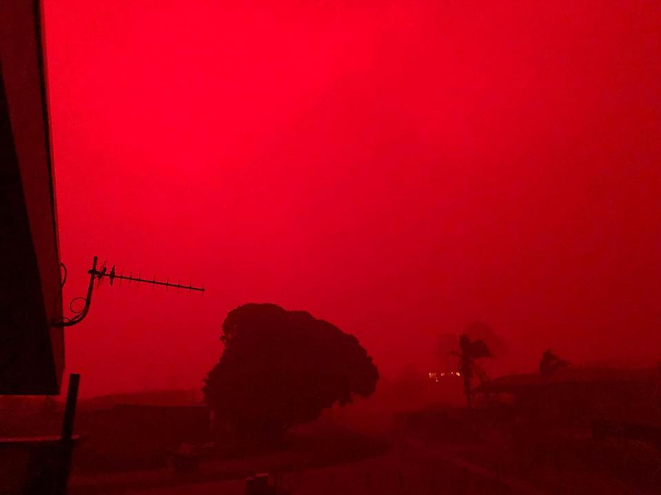 Aa red sky as bushfires approach Mallacoota in East Gippsland, Victoria.