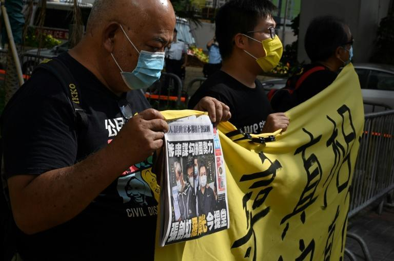 Supporters of the two Apple Daily executives protest outside Saturday's court hearing