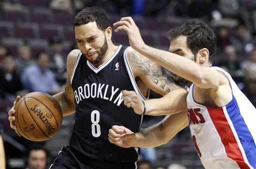 Brooklyn Nets guard Deron Williams (8) is tightly guarded by Detroit Pistons' Jose Calderon, right, of Spain, during the first half of an NBA basketball game Monday, March 18, 2013, in Auburn Hills, Mich. (AP Photo/Duane Burleson)