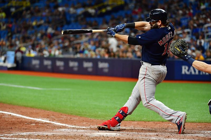 ST PETERSBURG, FLORIDA - SEPTEMBER 20: Mitch Moreland #18 of the Boston Red Sox hits a 2-run homer off of Emilio Pagan #15 of the Tampa Bay Rays in the ninth inning of a baseball game at Tropicana Field on September 20, 2019 in St Petersburg, Florida. (Photo by Julio Aguilar/Getty Images)
