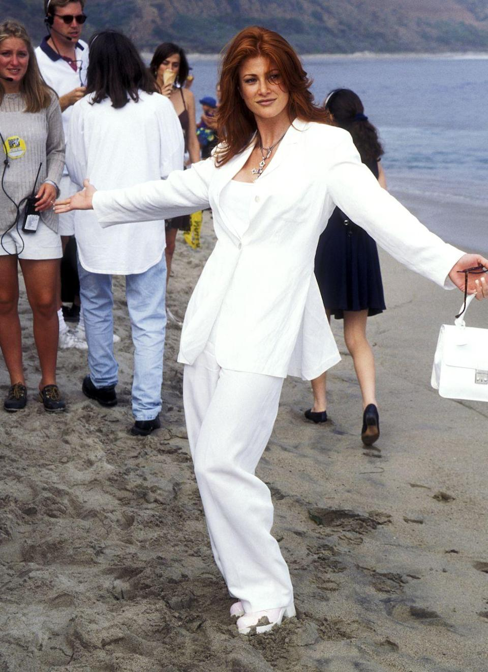 <p>Actress and model Angie Everhart, striking a pose in an all white ensemble. </p>