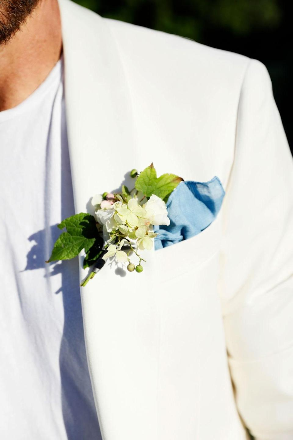 """""""The talented Missi Flowers made boutonnieres which I paired with a hand-dyed Camp Isidro linen handkerchief,"""" Dean says."""
