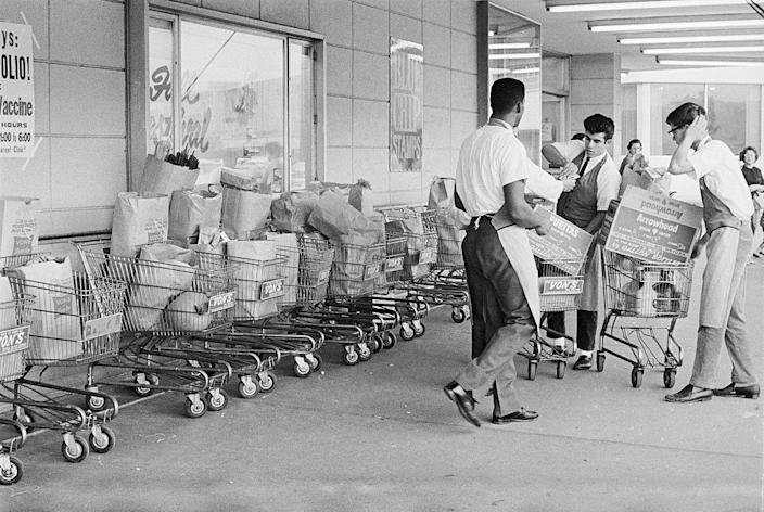"""<p>Sylvan Goldman got the idea for shopping carts from <a href=""""https://www.mentalfloss.com/article/26470/brief-history%E2%80%94and-future%E2%80%94-shopping-cart"""" rel=""""nofollow noopener"""" target=""""_blank"""" data-ylk=""""slk:two folding lawn chairs"""" class=""""link rapid-noclick-resp"""">two folding lawn chairs</a>. Before then, customers carried their groceries in baskets. It took some coaxing to get people to try the new invention — men were embarrassed to admit they didn't want to carry the basket and women claimed it was too similar to a stroller — but by the '40s most stores had adapted the idea.</p>"""