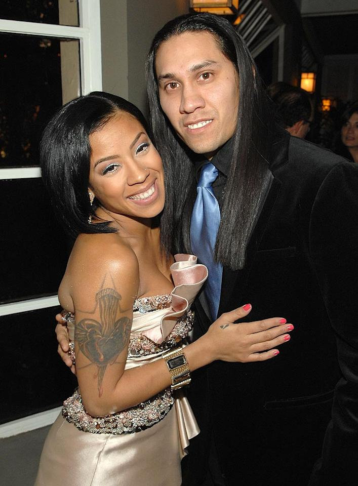 """A tatted-out Keyshia catches up with Taboo of the Black Eyed Peas. How does Taboo keep his long locks so shiny? John Shearer/<a href=""""http://www.wireimage.com"""" target=""""new"""">WireImage.com</a> - February 4, 2009"""
