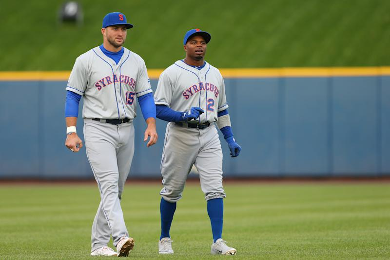 ALLENTOWN, PA - APRIL 30: Tim Tebow #15 and Rajai Davis #21 of the Syracuse Mets warm up before a AAA minor league baseball game against the Lehigh Valley Iron Pigs on April 30, 2019 at Coca Cola Park in Allentown, Pennsylvania. (Photo by Rich Schultz/Getty Images)