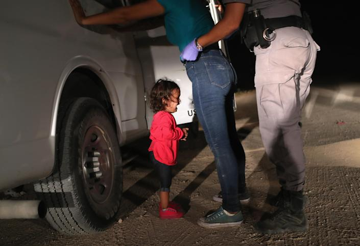 """<p>A two-year-old Honduran asylum seeker cries as her mother is searched and detained near the U.S.-Mexico border on June 12, 2018 in McAllen, Texas. The asylum seekers had rafted across the Rio Grande from Mexico and were detained by U.S. Border Patrol agents before being sent to a processing center for possible separation. Customs and Border Protection (CBP) is executing the Trump administration's """"zero tolerance"""" policy towards undocumented immigrants. U.S. Attorney General Jeff Sessions also said that domestic and gang violence in immigrants' country of origin would no longer qualify them for political asylum status. (Photo: John Moore/Getty Images) </p>"""