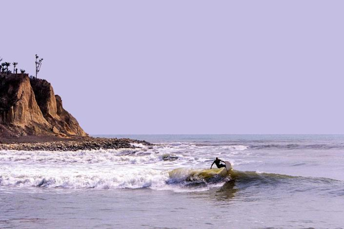 Angola, Bengo, surfing at Cabo Ledo on groundswells from the south Atlantic Ocean