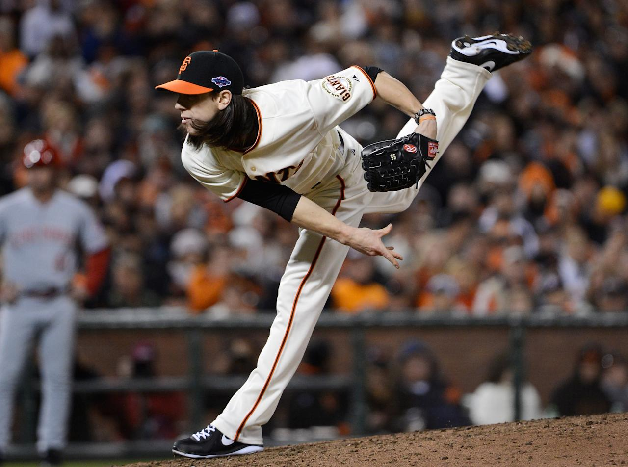 SAN FRANCISCO, CA - OCTOBER 07:  Tim Lincecum #55 of the San Francisco Giants pitches against the Cincinnati Reds in the sixth inning of Game Two of the National League Division Series at AT&T Park on October 7, 2012 in San Francisco, California.  (Photo by Thearon W. Henderson/Getty Images)