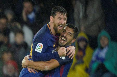 Soccer Football - La Liga Santander - Real Sociedad vs FC Barcelona - Anoeta Stadium, San Sebastian, Spain - January 14, 2018 Barcelona's Lionel Messi celebrates with Luis Suarez after scoring their fourth goal REUTERS/Vincent West