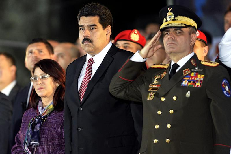 Venezuelan President Nicolas Maduro (C), First Lady Cilia Flores (L) and Defense Minister Vladimir Padrino Lopez are pictured at an event in Caracas on December 9, 2014