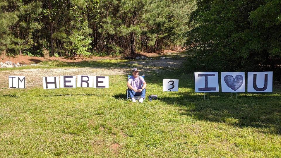 Mr Crockell sits with his signs outside his wife's hospital room. Source: Dennis Cockrell