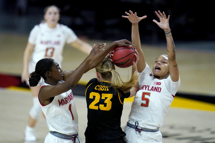 Iowa forward Logan Cook (23) faces pressure from Maryland guard Diamond Miller (1) and forward Alaysia Styles (5) during the second half of an NCAA college basketball game, Tuesday, Feb. 23, 2021, in College Park, Md. Maryland won 111-93. (AP Photo/Julio Cortez)